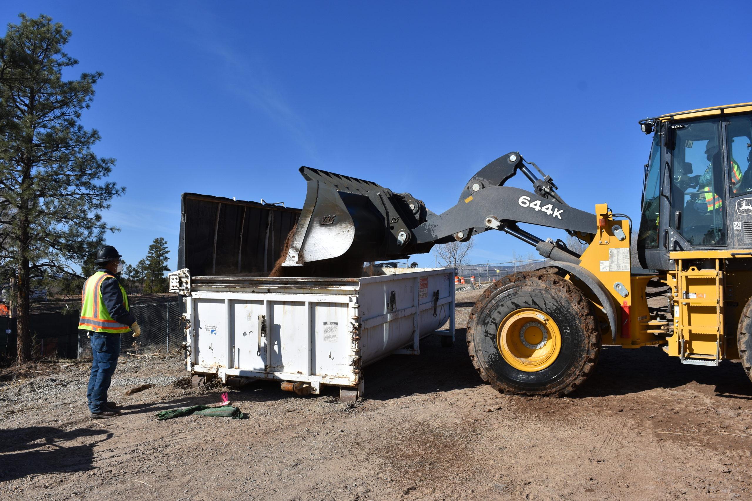 Depositing dirt into bin